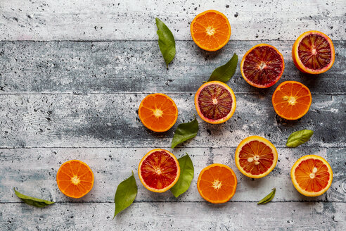 Halves of blood oranges, tangerines and leaves - SARF04099