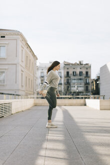 Young woman workout at city, Lleida, Catalonia, Spain. - JPF00343