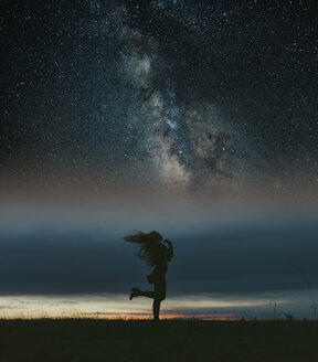 Silhouette of a woman in nature at sunset with stars, Lleida, Catalonia, Spain. - JPF00349