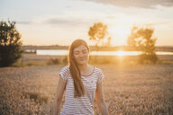 Portrait of young woman relaxing in nature at sunset - JSCF00147