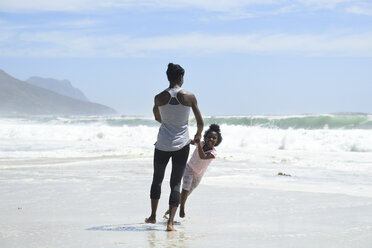 Happy mother and daughter having fun on the beach - ECPF00407
