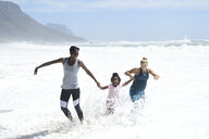 Mother with daughter and friend having fun in surf on the beach - ECPF00410