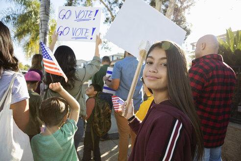 Portrait confident Latinx tween girl canvassing voters with neighbors - HEROF19228