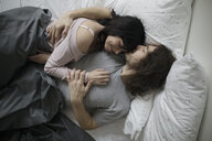 Affectionate, romantic couple cuddling in bed - HEROF19526