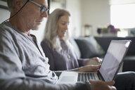 Senior couple using laptop - HEROF20120