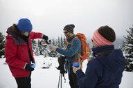 Friend skiers enjoying coffee break in snow - HEROF20603
