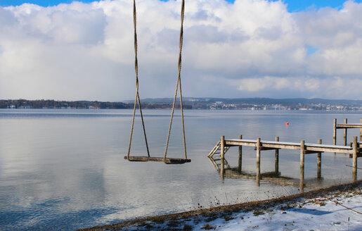 Empty swing near pier, Lake Starnberg, Bavaria, Germany - CUF48801