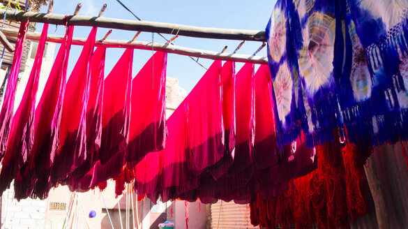 Dyed textiles hung out to dry, Marrakech, Morocco - CUF48810