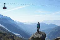 Mountain climber at summit, Chamonix, Rhone-Alps, France - CUF48906