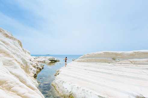 Woman enjoying seaside, Punta Bianca National Reserve, Agrigento, Sicily, Italy - CUF48996