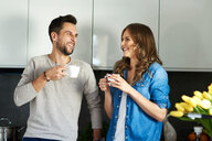 Couple drinking coffee in kitchen - CUF49110
