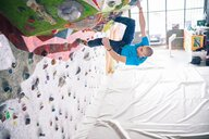 Climber on climbing wall - CUF49140