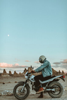 Motorcyclist on stationary bike, Trona Pinnacles, California, US - ISF20623