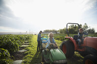 Farmers with tractors on sunny farm - HEROF20703