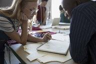 Fashion designers sketching at workbench in studio - HEROF20742