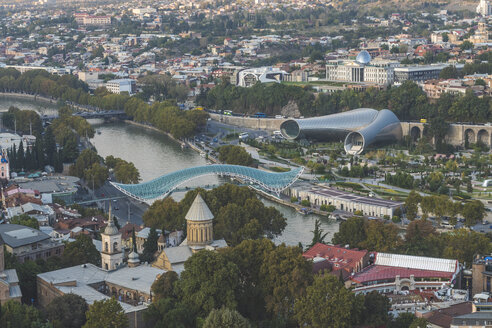 Georgia, Tbilisi, view from fortress Narikala on old town with Bridge of Peace, concert hall and parliament - KEBF01089