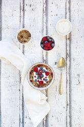 Bowl of muesli with Greek yogurt, popped quinoa, raspberries, blueberries and pomegranate seed - LVF07766