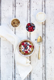 Bowl of muesli with Greek yogurt, popped quinoa, raspberries, blueberries and pomegranate seed - LVF07766