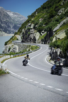Switzerland, Grimsel Pass, two bikers on mountain pass road - PPXF00170