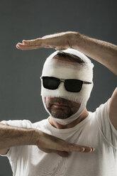 Man with gauze bandage, beauty craze - MAEF12796