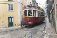 Portugal, Lisbon, Old town, Red tram in alley - FC01676
