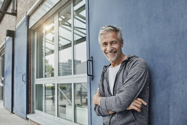 Portrait of laughing mature man in front of gym - RORF01734