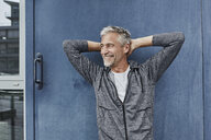 Portrait of laughing mature man in front of gym - RORF01740