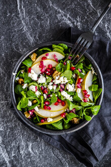 Bowl of mixed salad with lamb's lettuce, feta, pear, pomegranate seed and walnuts - SARF04104
