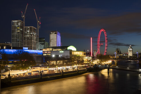 United Kingdom, England, London, Queen Elizabeth Hall, Royal Festival Hall and London Eye at River Thames at night - WIF03807