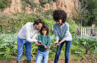 hapy family holding soil in their cupped hands - GEMF02754