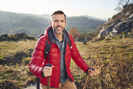 Portrait of smiling man on a hiking trip in the mountains - BSZF00955