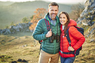 Portrait of happy couple on a hiking trip in the mountains - BSZF00976
