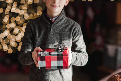 Boy holding Christmas gift - ISF20744