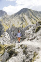 Austria, Tyrol, woman on a hiking trip in the mountains - FKF03303