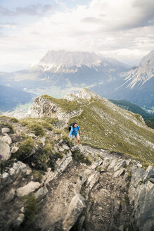 Austria, Tyrol, woman on a hiking trip in the mountains - FKF03324