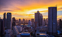 Sunset over skyscrapers, State Tower in background, Bangkok, Thailand - ISF20847