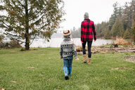 Mother and son on walk by lake, Kingston, Ontario, Canada - ISF20877