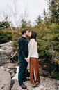 Couple holding hands and kissing, Tobermory, Canada - ISF20940