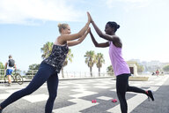 Two happy women doing fitness exercises outdoors - ECPF00478