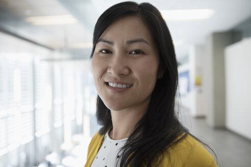 Close up portrait smiling Asian businesswoman - HEROF21140