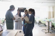 Surgeon, doctor and nurses talking in hospital - HEROF21735