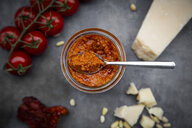 Glass of tomato pesto and ingredients - LVF07785