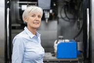 Portrait of confident senior businesswoman in a factory - DIGF05778