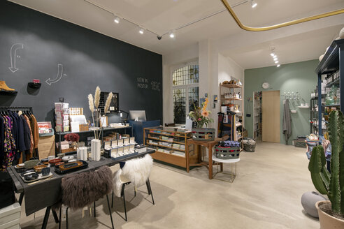 Interior of a modern concept store, displaying fashion - PESF01501