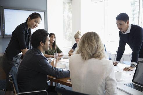 Business people talking in conference room meeting - HEROF21932