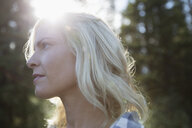 Close up pensive, serene blonde woman looking away - HEROF22004