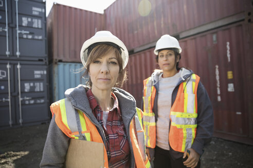 Portrait serious female workers in industrial container yard - HEROF22310