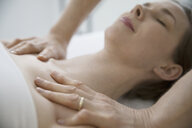 Masseuse massaging chest and shoulders of serene woman - HEROF22517