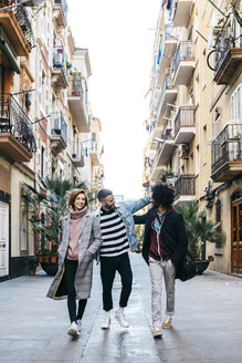 Three happy friends walking in the city - JRFF02613