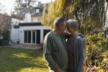 Affectionate senior couple embracing in garden - KNSF05559